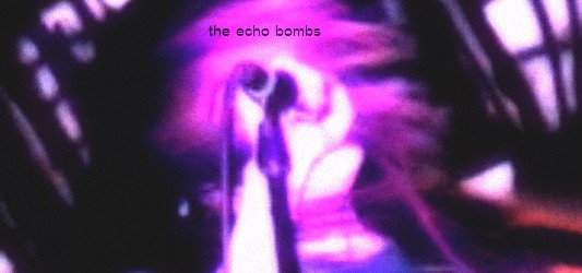 Rising from the ashes of The Analog Society, The Echo Bombs appear to have emerged triumphant with an engaging sound that is both unique yet right in line with some growing local trends. In the last year or so there has been a wonderful emerging group of fierce, electrically charged pop/rock bands throughout this scene fronted by amazing women of vision. In my mind The Echo Bombs join the ranks of Zero Zero, Russian Arms and Optics, Therapist, PALMS, The Madera Strand, Factories, Fairy Bones and a few others where a brilliant feminine vision is combined with amazing gutsy music...